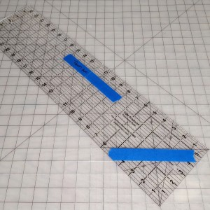 Acrylic ruler marked with painter's tape